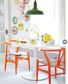 adorable, colorful dining room; love the green light fixture