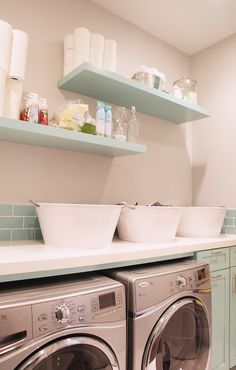 Brooke Jones Designs: Turquoise blue laundry room with light gray walls paired with turquoise subway tile ...