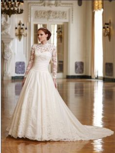 Pretty lace, long sleeved wedding dress :)