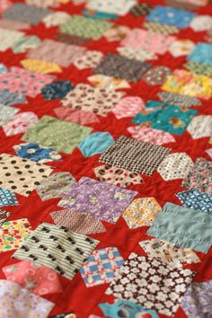 Oh My Stars! quilt with stars in the sashing.  Scrappy love!