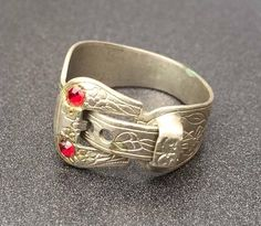 Very cool vintage buckle ring with nice stamped floral detailing and set with two red rhinestones. I think the rhinestones were replaced at some point as there is some faint glue residue noticeable around them up close. Size 6.5, looks like its adjustable with the buckle but I dont