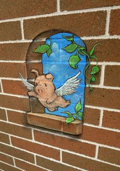 by David Zinn ... ...that bottom ledge is not there...it is just flat brick wall...