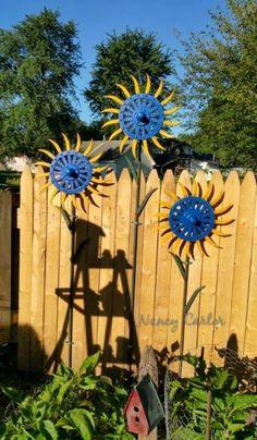 Gears and gadgets as garden art Nancy Carter's drought tolerant sunflowers