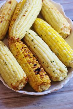Herb and Parmesan Roasted Corn.. Fresh shucked corn is slathered with a compound butter containing fresh herbs, Parmesan cheese and a seasoning blend, wrapped in foil and grilled