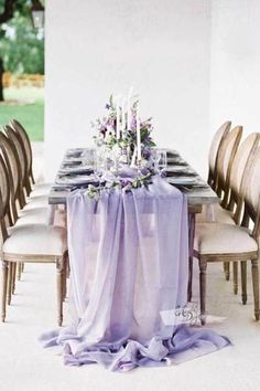 This silky chiffon Lavender table runner drapes gracefully across the table and flows onto the floor in dreamy pools of fabric. Easily adds a touch of romantic and elegance to the bridal shower, wedding or special event. Includes matching ribbon ties for the option of gathering the soft luminous folds of fabric at ei