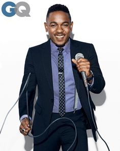 Kendrick Lamar in a suit, shirt, and pants by Giorgio #Armani.