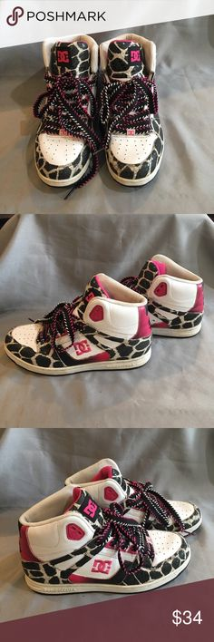 DC Pink, Black and White Leopard Pattern Hightops DC Pink, Black and White Leopard Pattern Hightops. Well loved with plenty of life left in them. Multi color laces that are black, pink and white. DC Shoes Sneakers