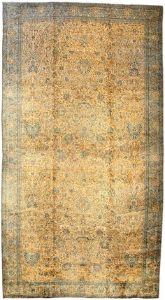 An Indian Carpet BB2340 - A highly decorative early 20th century antique Indian rug, the camel field with an allover lattice of delicate flow ...