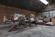 When an urban explorer ventured inside this undisclosed hangar somewhere in continental Europe, he discovered a wealth of abandoned light aircraft and other forsaken aviation technology that looked like it had been there for years.