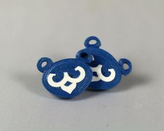 Blue bear cub stud earrings handmade from paper quilling in shape of cub bear face on silver posts.