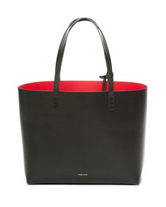 Mansur Gavriel won over editors with their no-fuss bucket bag, and this sleek tote is no exception. See more on our list of 10 affordable luxury trends. Mk Handbags, Handbags Michael Kors, Purses And Handbags, Designer Totes, Designer Handbags, Tote Bag, Large Tote, Fashion Bags, Women's Fashion