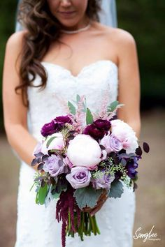 "A ""Plum Perfect"" October Wedding Design! Bridal Bouquet designed with blush peony, lavender roses, pops of wine burgundy ranunculus, bleeding heart amaranthus, dusty miller and loropetalum."