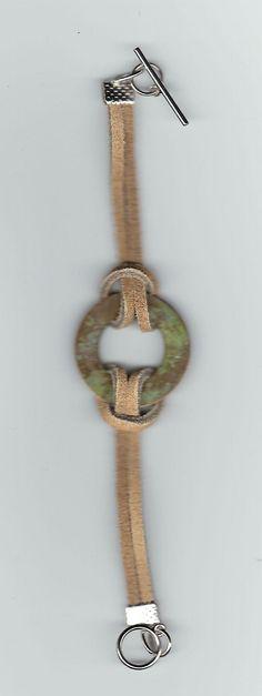 Skinnreim med en ring laget i stein. Faksimile fra cost21.com