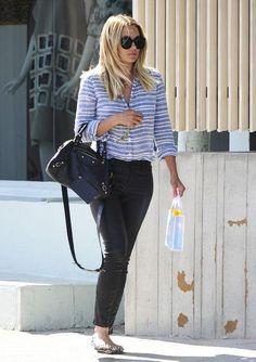 So, we're obsessed with Lauren Conrad's style. Click to see outfits we love, including these black skinny jeans, striped shirt, and black Balenciaga bag.