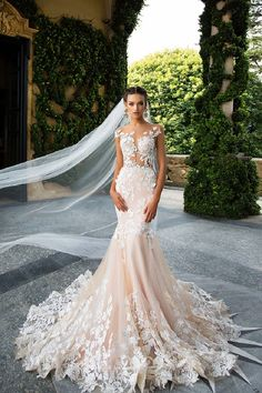 Beautiful mermaid wedding dress with sheer mixed with lace bodice and cascading lace detail.