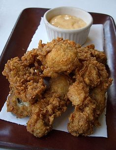 Southern Style Deep Fried Oysters I was raised with a tradition of going to my Uncle Roy's house Christmas morning & having oysters. We would have fried & stewed. Some family members would eat them raw but I just couldn't. We finally started meeting at Dad's Christmas morning & in recent years I cooked the oysters. Christmas 2011 I tried my 1st raw oyster! Taste wise they were about the same but I think I prefer them fried over all.