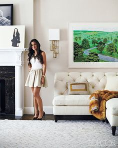Ivory tufted sofa and faux fur throw....sexy. I think I have that skirt.