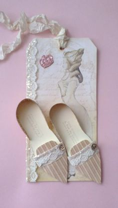Paper Shoe(s) on a tag..  Cute!..   ALTERED ARTIFACTS
