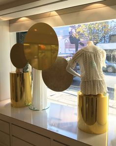 Creating a beautiful, contemporary and alluring installation for Christmas. Using simple circular discs each using Doratape metallic finishes. The mannequin bases emulating the discs completed in mirrored gold vinyl. A hand dressed Christmas evergreen garland framing the facade with warm LED lights and mirror gold acrylic discs.