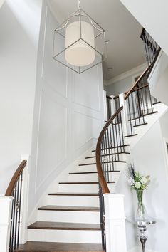 Staircase designed by Enviable Designs - We created a stunning entryway using mouldings and a variety of finishes. The white risers on the stairs creates a lasting impression to all visitors.