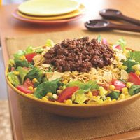 Mexican Beef Taco Salad   INGREDIENTS  Serves:     Prep: 10min Cook: 7min Total: 17min  1 pound 85% lean ground beef  1 package (3/4 ounce) taco seasoning  1/4 cup water  1 head romaine lettuce, chopped  1 can (11 ounces) corn, drained  2 tomatoes, chopped  1 small jar (8 ounces) low-fat Catalina salad dressing  1 package (8 ounces) baked tortilla chips, crushed