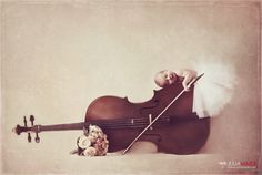 newborn.~ LOVE this idea. Seriously considering snagging my daughters cello for a future shoot.