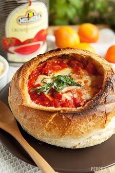 Cheesy Tomato Soup with Garlic, Mozzarella, Gouda, Parmesan in a Bread Bowl. I made this last night and added more parmesan....it is delicious and will be the new base for all my spaghetti sauces!! KI