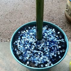Put colored crystals in different colors on top of soil of potted plants it makes the moisture stay in and the crystals bling in the sun.  Just adds a pretty feature to a plant.