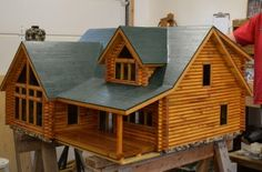 Log dollhouse that my hubby made for our 3 granddaughters
