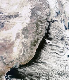 Clouds forming off a mountain range in Russia, seen from space!