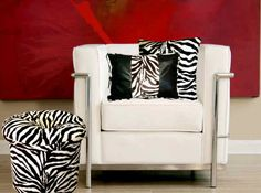 "Zebra-Kenya Ebony Pillow  The African Plains come to life in this truly unique pillow. Soft to the touch, a great addition to any sofa, chair, or bed. The Zebra Faux Fur, is a white back ground with black zebra stripes. The Faux Leather is a rich Ebony Black. The back side of the pillow is Faux Fur Zebra. Available in two sizes.    Damp Cloth Clean.  None removable cover.  100% Polyester.     Rectangle Approximately:19"" x 13"". Square Approximately: 19""x19"".   $59.99-$69.99  SALE $52.00-$42.00"