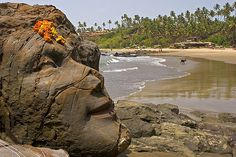 Face of Shiva rock carving on Little Vagator Beach in Goa India