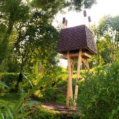 "The Wild Thing is a ""creature-like"" cabin that stands tall above a Latvian wildflower meadow - Designed and built by a group of students at the Riga Technical University summer school"