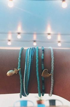 Check the way to make a special photo charms, and add it into your Pandora bracelets. Tropical Blues | Pura Vida Bracelets