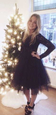 Journal celebrated Christmas in her black tulle skirt. We love the look!