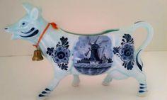 Vintage cow creamer, Delft Blue porcelain with bell, Holland. $12.00, via Etsy.