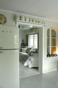 Love this shelf over the doorway. Such fantastic use of wasted space!