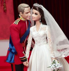 Royal Wedding William and Catherine Barbie dolls. She wears a Barbified Duchess's miniature Alexander McQueen wedding gown, trimmed in lace and faux pearl buttons and  sparkling earrings and tiara meant to represent the 1936 Cartier Halo Tiara and matching diamonds lent to Kate by QE.  Will (with a notably full head of hair) wears red Irish Guard uniform with a royal blue sash.