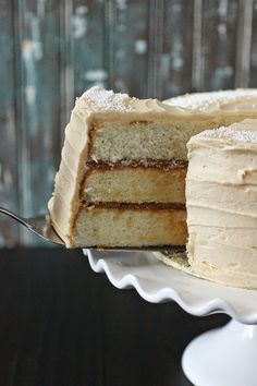 Vanilla Bean Cake with Whipped Dulce de Leche Frosting mmm ~ white cake from Sky High Triple Layer Cakes book