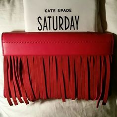 """HPx2!  kate spade saturday • red fringe clutch Brand new Kate Spade Saturday red fringe clutch. Perfect to hold a ton of stuff for a night out. Or add a pop of color to a casual outfit! Comes with dust bag.  02/20/2016 """"Girly Girl"""" Host Pick!  Thank you @cali08!!!   03/23/2016 """"Total Trendsetter"""" Host Pick!  Thank you @puddpudd0!  kate spade Bags Clutches & Wristlets"""
