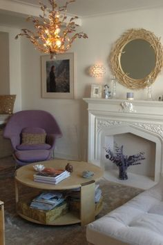 by Juliet Pegrum Design    Living room, lavender womb chair and grey velvet sectionals
