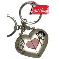 Сърце, разделено на две части - двоен сувенир, един за него и един за нея - с магнитчета ...Когато двете части от сърчицето се доближат, то става