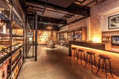 View of champagne and spirits section and tasting area at Dan Murphys Cellar Prahran. Lighting design by Glowing Structures.