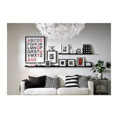 Like the two picture ledges with a big piece of art filling blank space for an asymmetrical but balanced look.