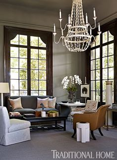 Tailored menswear inspired the refined lines on the furniture in this living area. - Photo: Emily Jenkins Followill / Design: Robert Brown