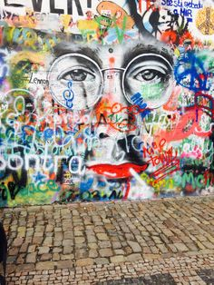 John Lennon wall Courtesy of Molly Winik // I just love how his wall changes and evolves!