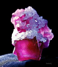 Cranberry Fluorite crystals covered with Calcite crystals by howie516, via Flickr