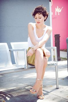 Wearing a pencil skirts by Badgley Mischka. Paired with a white tank from Topshop, vintage jewelry, Coach clutch, and Prada crystal sandals.