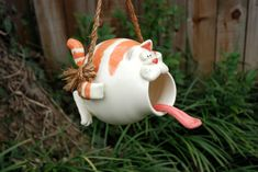 Orange Tabby Cat disguised as a Bird House or Bird Feeder. $85.00, via Etsy.