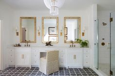 White and gold bathroom with gray floor tiles Hulton Sconce Jacqueline pendant chandelier circa lighting